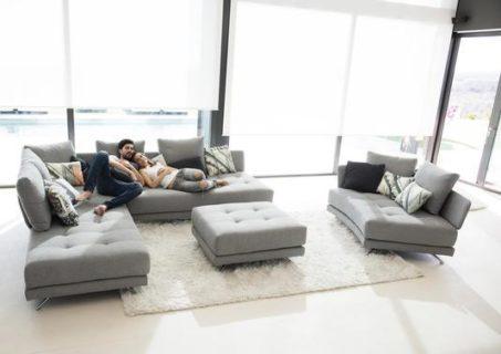 Canapé d'angle modulable assise matelassée coussins jetés